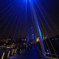 Photo taken at Hungerford & Golden Jubilee Bridges by Stijn O. on 8/23/2013