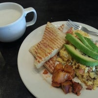 Photo taken at Mondo Caffe by Melissa X. on 4/19/2013
