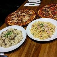 Photo taken at Alfresco Italian Restaurant by Poh C. on 6/25/2015