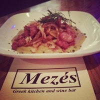 Photo taken at Mezes Kitchen & Wine Bar by Mezes Wine Bar & Greek Kitchen m. on 12/28/2013