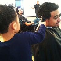 Photo taken at Top of the Line Barbershop by Ramon C. on 3/5/2013