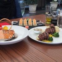 Photo taken at Déjàvu Restaurant by Amitis H. on 5/20/2016