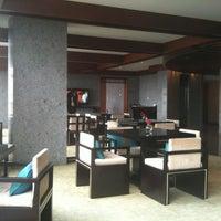 Photo taken at Millennium Hongqiao Hotel Shanghai by AA M. on 5/22/2013