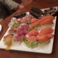 Photo taken at Yosuki Sushi House by Amandinha A. on 1/20/2013