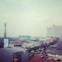 Photo taken at Jalan Margonda Raya by Nirwan S. on 6/9/2015