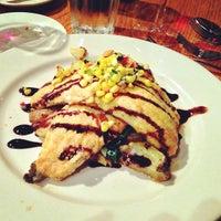 Photo taken at Irregardless Cafe by Pam ☕️ O. on 4/6/2013