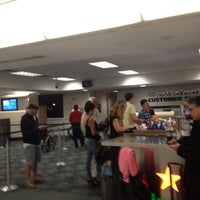 Photo taken at Gate E5 by Jeremy N. on 12/9/2012
