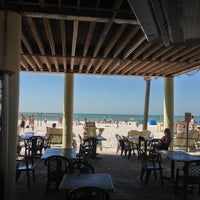 Photo taken at Undertow Beach Bar by Greg N. on 2/9/2013