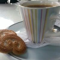 Photo taken at Café Arabico by Victoria T. on 9/12/2014