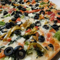 Photo taken at Brother's Pizza by Brother's Pizza on 9/12/2014