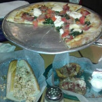 Photo taken at Tonelli's Pizza Pub by Christopher M. on 12/27/2012