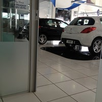 Photo taken at Champion (Peugeot) by Priscila R. on 10/17/2012
