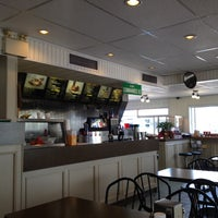 Photo taken at Quartiers Burgers & Frites Resto by Chuck S. on 7/18/2014
