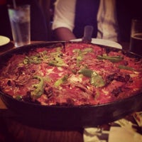 Photo taken at Pequod's Pizzeria by Manny G. on 2/3/2013