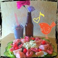 Photo taken at Mória Café by Luiggina Y. on 4/21/2015