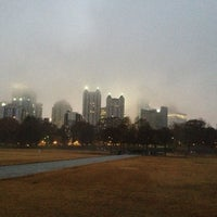 Photo taken at Piedmont Park Active Oval by Mari F. on 12/9/2012