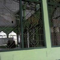 Photo taken at Masjid Ainul Yaqin by cliffbonie on 3/16/2014