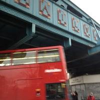 Photo taken at Kilburn London Underground Station by Napolitan K. on 12/24/2012