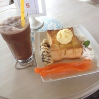 Photo taken at cafe@home by Kesaraporn J. on 10/7/2014