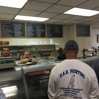 Photo taken at Fratelli's Deli Salumeria Catering by Axel L. on 6/9/2016