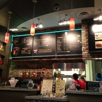 Photo taken at Nando's Flame-Grilled Chicken by Andrew W. on 4/10/2013