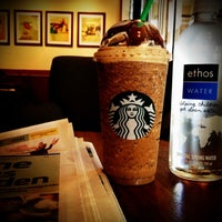 Photo taken at Starbucks by iam 7. on 10/4/2012