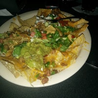 Photo taken at Spectators-Sports Bar & Grill by Ruben G. on 10/7/2014