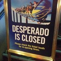 Photo taken at The Desperado Roller Coaster by Andrew W. on 4/19/2014
