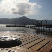 Photo taken at Ponta das Caranhas by Hugo L. on 10/7/2012