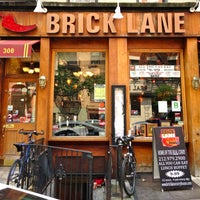 Photo taken at Brick Lane Curry House by The Corcoran Group on 7/1/2013