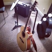 Photo taken at Wood & Steel Music Studios by Heather K. on 9/26/2014