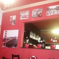 Photo taken at Le Rouge Confiserie & Caffé by Clarissa C. on 8/7/2015