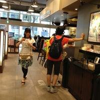 Photo taken at Tsutaya Book Store Tenjin by ipc10396 on 6/11/2013