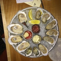 Photo taken at Dylan's Oyster Cellar by Jonathan K. on 5/30/2014