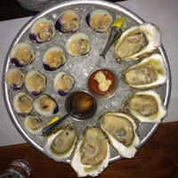 Photo taken at Dylan's Oyster Cellar by Jonathan K. on 8/28/2014
