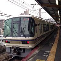 Photo taken at JR Nishikujō Station by Ken Y. on 6/30/2013