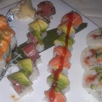 Photo taken at Uptown Sushi by Lisa C. on 6/1/2013