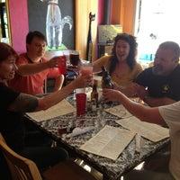 Photo taken at White Dog Black Cat Cafe by Gina C. on 7/26/2013