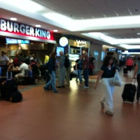 Photo taken at Concourse C by Beatriz D. on 10/25/2012