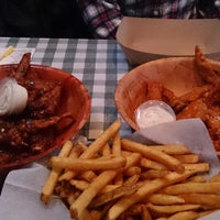 Photo taken at Gators Wing Shack by Greg M. on 3/19/2014