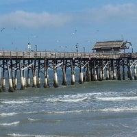 Photo taken at Cocoa Beach Pier by Karen B. on 12/10/2012