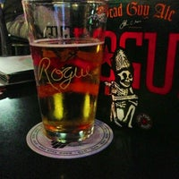 Photo taken at Rogue Ales Public House & Brewery by Aron B. on 4/6/2013