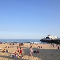 Photo taken at Bournemouth Beach by Lucy E. on 7/9/2013