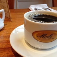Photo taken at Meli Cafe & Juice Bar by Casey S. on 4/14/2013