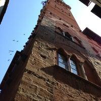 Photo taken at Torre Guinigi by Tommaso F. on 6/16/2013