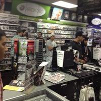 Photo taken at GameStop by Alberto C. on 3/12/2013