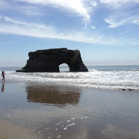 Photo taken at Natural Bridges State Beach by Lulu on 3/10/2013
