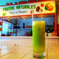 Photo taken at Tacombi Café El Presidente by Laura C. on 12/3/2014