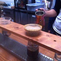 Photo taken at Andante Coffee Roasters by Chrissy S. on 9/27/2013