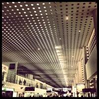 Photo taken at Terminal 2 by Alexis T. on 3/9/2013